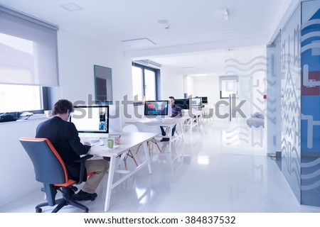 software company office. startup business software developer working on computer at modern office company w