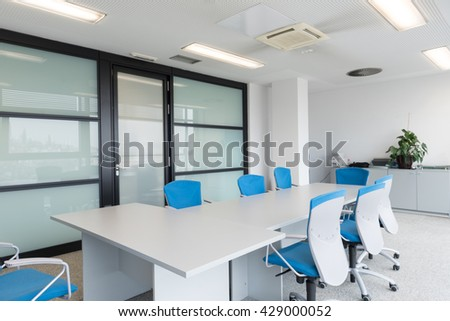 startup business, young creative  people group entering meeting room,  modern office interior and motion blur - stock photo
