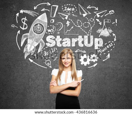 Startup concept with confident young businesswoman and rocket ship sketch on concrete background - stock photo