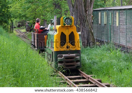 STARY PLZENEC, CZECH REPUBLIC - MAY 14, 2016: Mining locomotive BND30 with tourists on narrow-gauge railway. Outdoor museum in Stary Plzenec, Czech republic, Europe. - stock photo