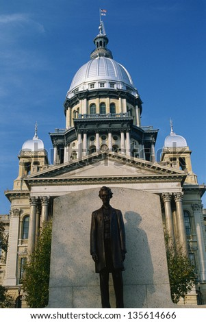 State Capitol Building of Illinois with the statue of Abraham Lincoln in the foreground - stock photo