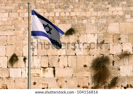 State flag of Israel against the background of the Wailing wall in Jerusalem, Israel. - stock photo