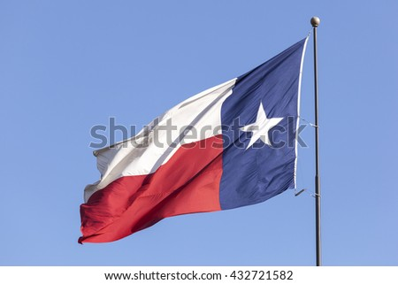 State flag of Texas against blue sky. United States of America