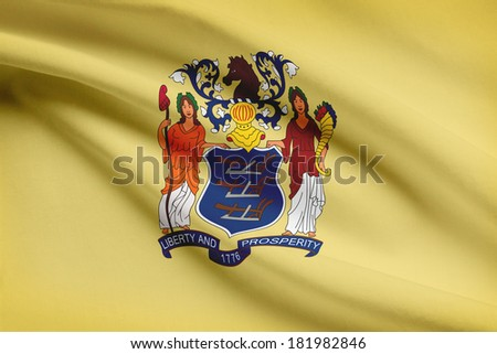 State of New Jersey flag blowing in the wind. Part of a series. - stock photo