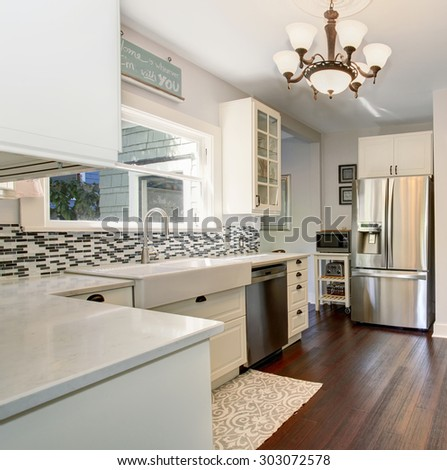 State Of The Art Kitchen With Stainless Steel Appliances And Hardwood Floor.