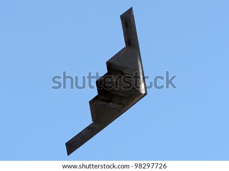 State of the art stealth bomber in flight - stock photo