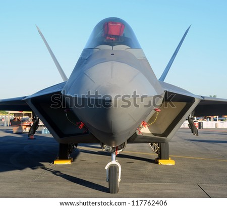 State of the art stealth fighter jet front view - stock photo