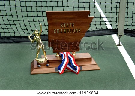 State tournament trophy in tennis for Arkansas.  (name removed) - stock photo
