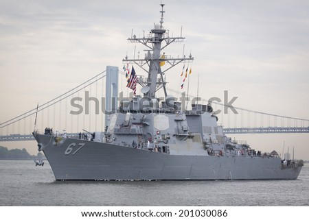 STATEN ISLAND, NY - MAY 21, 2014: Guided-missile destroyer USS Cole (DDG 067) approaching Sullivans Piers with the Verrazano-Narrows Bridge in the background.  The ship is part of Fleet Week NY. - stock photo