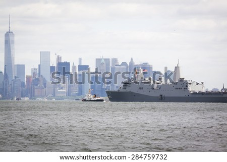 STATEN ISLAND, NY - MAY 20 2015: USS San Antonio (LPD 17) on the Hudson River near the Freedom Tower of One World Trade Center in Lower Manhattan during the Parade of Ships, which begins Fleet Week.  - stock photo