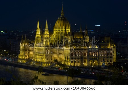 Static elevated telephoto shot clip of Hungarian Parliament at night in Budapest