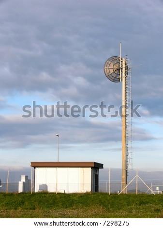 Station of transmitter with parabolic antenna - stock photo