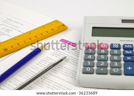 Stationary - Ruler, Pen, Pencil and Calculator - stock photo