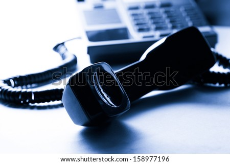 Stationary telephone receiver in closeup - stock photo