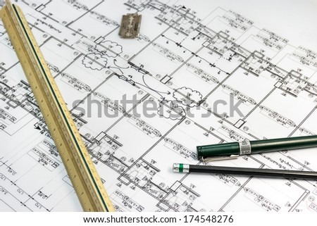 Stationary tools with architect plan documentas a background in still life concept - stock photo