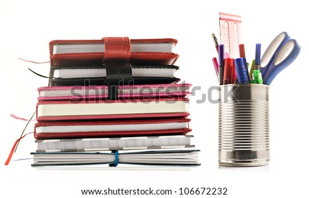 Stationery and books on white background with space for text - stock photo