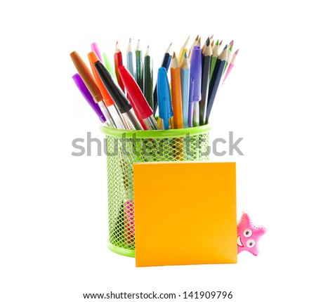 Stationery. Colored pencils in a pencil stand and stick notes over white background. - stock photo