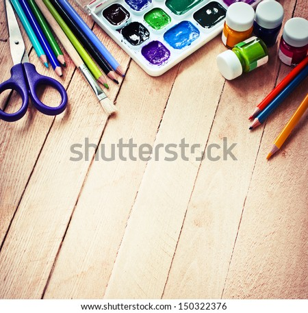 """stationery for school/School and office supplies frame, on wooden background/ """"back to school"""" background - stock photo"""