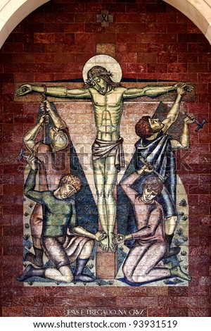 Stations of the Cross:Jesus is nailed to the cross; A panel of Portuguese tiles outside the shrine of Fatima - stock photo