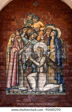 Stations of the Cross:Veronica wipes the face of Jesus; A panel of Portuguese tiles outside the shrine of Fatima - stock photo