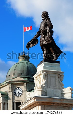 Statue and historical buildings in Quebec City - stock photo