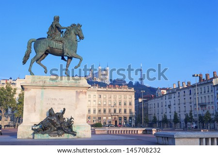 Statue and Notre Dame de Fourviere on a background - stock photo