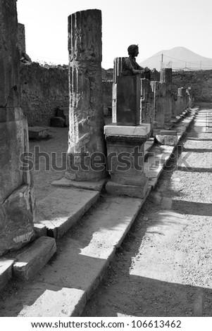 Statue and Stone Pillars, Pompeii, Italy - stock photo