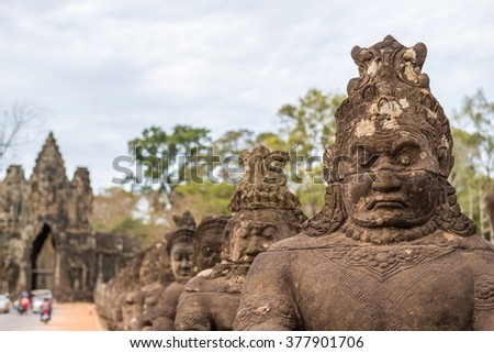 Statue at gate of Angkor Thom, Siem Reap, Cambodia