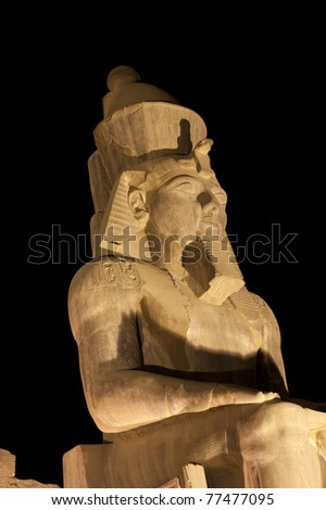 Statue at night in Luxor Temple of Ramses II isolated on black - stock photo
