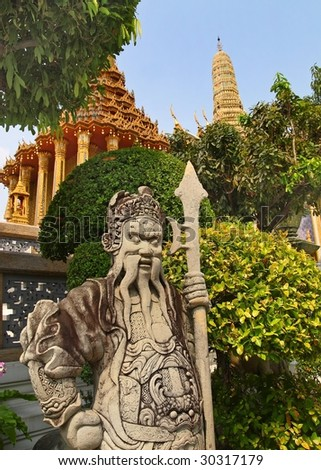 statue at the grand palace bangkok - stock photo