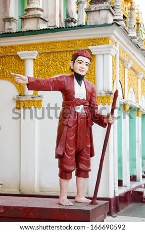 statue barefoot man with his staff, pointing the way, Shwedagon pagoda, Myanmar(Burma), Yangon(Rangoon) - stock photo