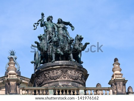 Statue Dionis and Ariadna chariot with four panthers on top of Dresden Opera Theatre - stock photo