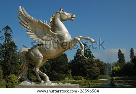 Statue flying horse pegasus a greek mythology figure in an irish garden