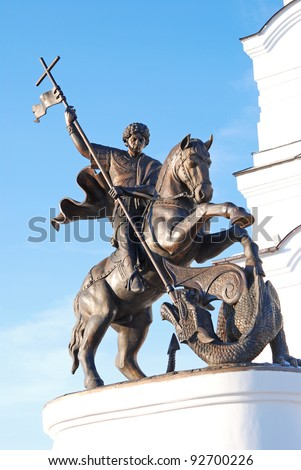 statue George the Victorious on the background of the church - stock photo