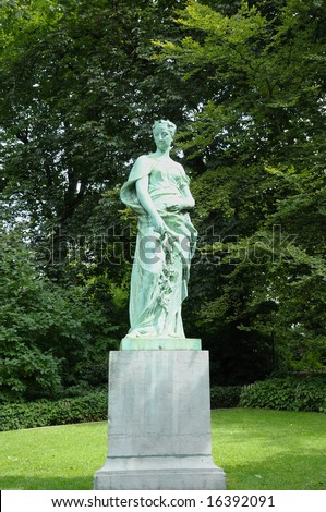 Statue in Brussels park on green trees background near metro Botanique