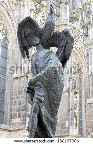 Statue in front of St. John's Cathedral at 's-Hertogenbosch - Netherlands - stock photo