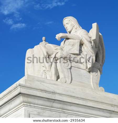 Statue in front of Supreme Court building. - stock photo