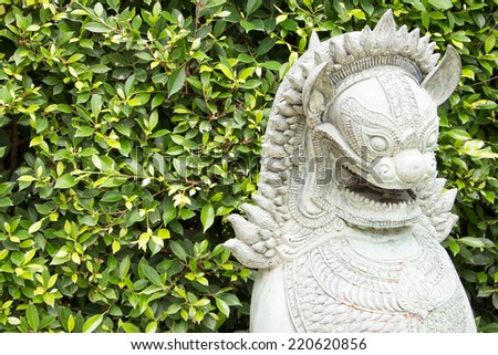 statue in stone of lion - stock photo