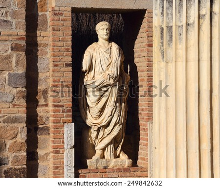 Statue in the archaeological ruins of the Roman Temple of Diana - 1Bc, Merida, Extremadura, Spain. UNESCO World Heritage site. (Selective focus ) - stock photo