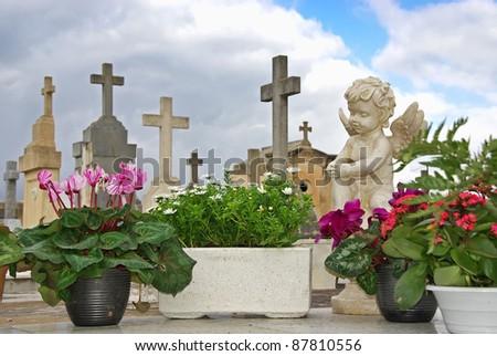 Statue in the cemetery of Alcudia (Majorca - Balearic Islands) - stock photo