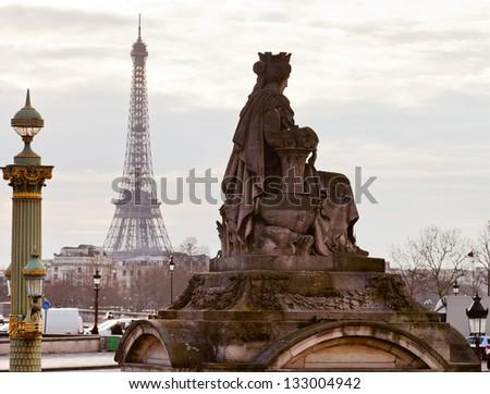 statue Marseille, column on place de la Concorde and Eiffel Tower in Paris - stock photo