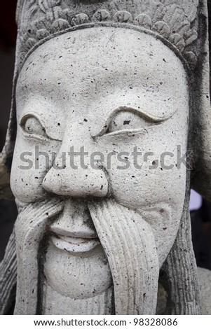 statue of a man in bangkok, thailand
