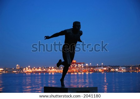 Statue of a sprinter (Roger Bannister) - stock photo