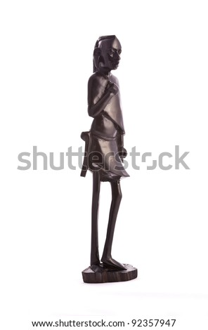 Statue of a warrior masai carved from ebony - Tanzania, Africa - stock photo