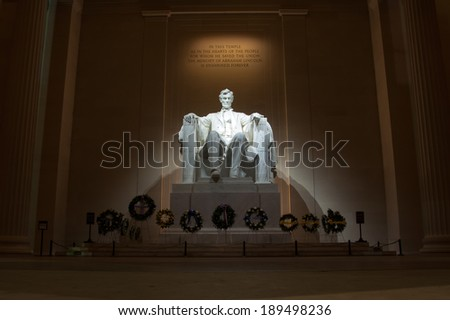 statue of abraham lincoln at the memorial in washington d.c. - stock photo