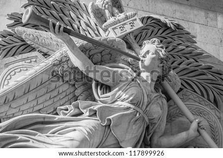 Statue of angel on the Arc de Triomphe in Paris, France - stock photo