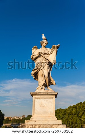 Statue of angel with on the bridge in front of Castel Sant'Angelo, Rome, Italy - stock photo