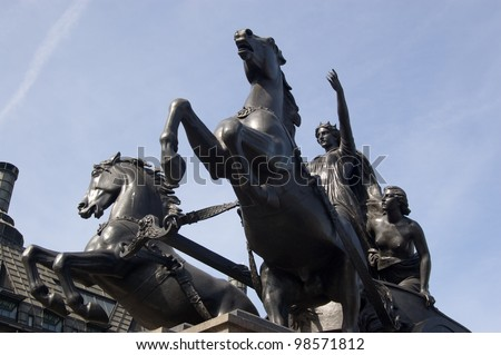 Statue of Boudica in her chariot.  The Queen of the Iceni tribe during the Roman Empire.  Also spelt Boudicca and Boadicea.  Statue erected on north bank of Westminster Bridge 1902. - stock photo