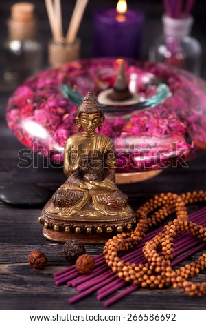 Statue of Buddha, incense and aromatic oils, meditation zen concept - stock photo