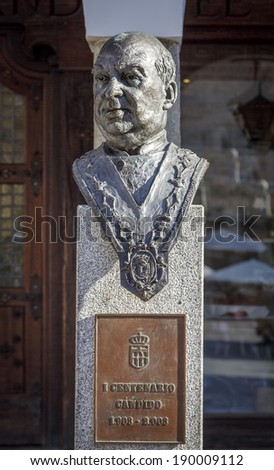 Statue of Candido greater Innkeeper Castilla, author of Santiago de Santiago located in Plaza del Azoguejo, Segovia - stock photo